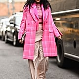 Give tan wide legs a jolt with electric pink on top and white shoes to finish.