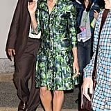Eva paired her knee-length green-and-blue printed silk dress with black peep-toes and exaggerated cat-eye sunglasses, creating yet another signature look.