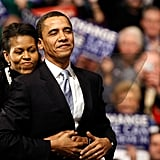 Michelle wraps her arms around Barack on New Hampshire primary night.