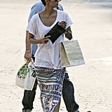 Halle Berry wore a maxi skirt with a slit while shopping with Olivier Martinez.