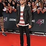 Joshua Bowman wore a striped t-shirt.