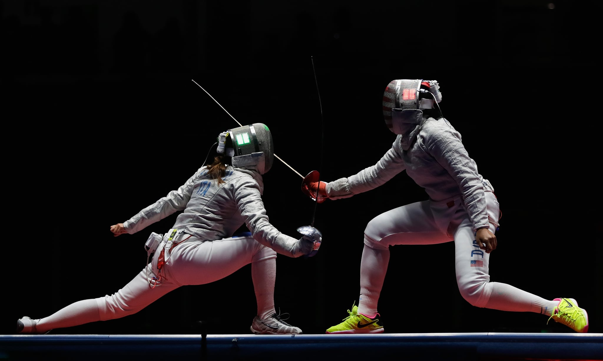 RIO DE JANEIRO, BRAZIL - AUGUST 13: Irene Vecchi of Italy competes against Ibtihaj Muhammad of the United States during the Women's Sabre Team bronze medal match between United States and Italy on Day 8 of the Rio 2016 Olympic Games at Carioca Arena 3 on August 13, 2016 in Rio de Janeiro, Brazil.  (Photo by Jamie Squire/Getty Images)