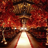 Getting married in the fall? Bring the gorgeous colors of the season indoors with autumnal trees lining your aisle.