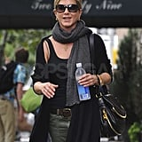 Jennifer Aniston carried a purse and a bottle of water.