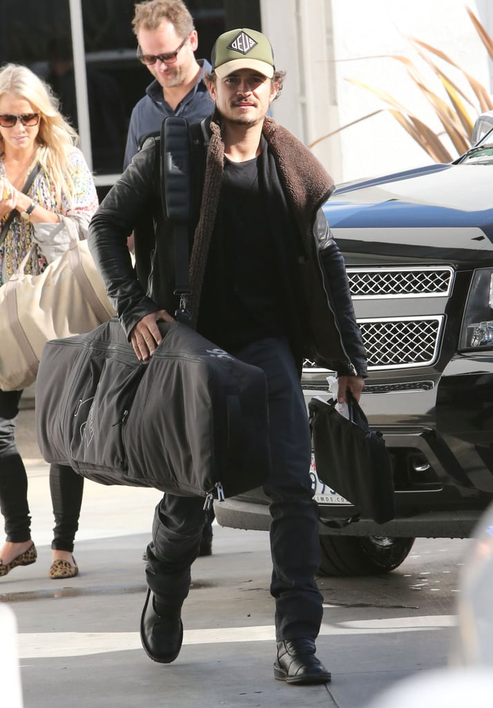 "Orlando Bloom toted his snowboard and other luggage as he boarded a private plane at LAX yesterday. He was solo for the trip out of town on a special day for his family — his son, Flynn, turned 2! His wife, Miranda Kerr, documented the celebrations on Instagram, sharing pictures of a blowup firetruck bounce house and a sign reading ""Happy 2nd Birthday Flynn!"" Although Orlando left town on Flynn's big day, he spent some quality time with his little guy and his wife in recent days. Miranda and Orlando shared a sweet kiss on Friday, when he picked her up from a spa in LA, and later she captured an adorable family moment on a walk with Flynn, which she posted on her Instagram account over the weekend.  Fame/Flynet"