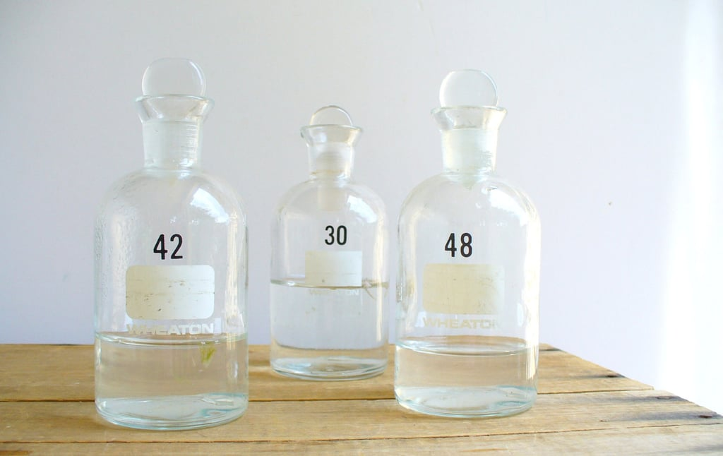 """For a haunted tablescape, fill these vintage glass bottles ($12) with candy or the """"potion"""" of your choice."""