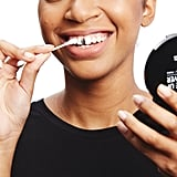 To remove the inky product from your teeth at the end of the night, use a Q-tip dipped in alcohol. You can also use a disposable mascara wand covered with olive oil to scrub away the residue.