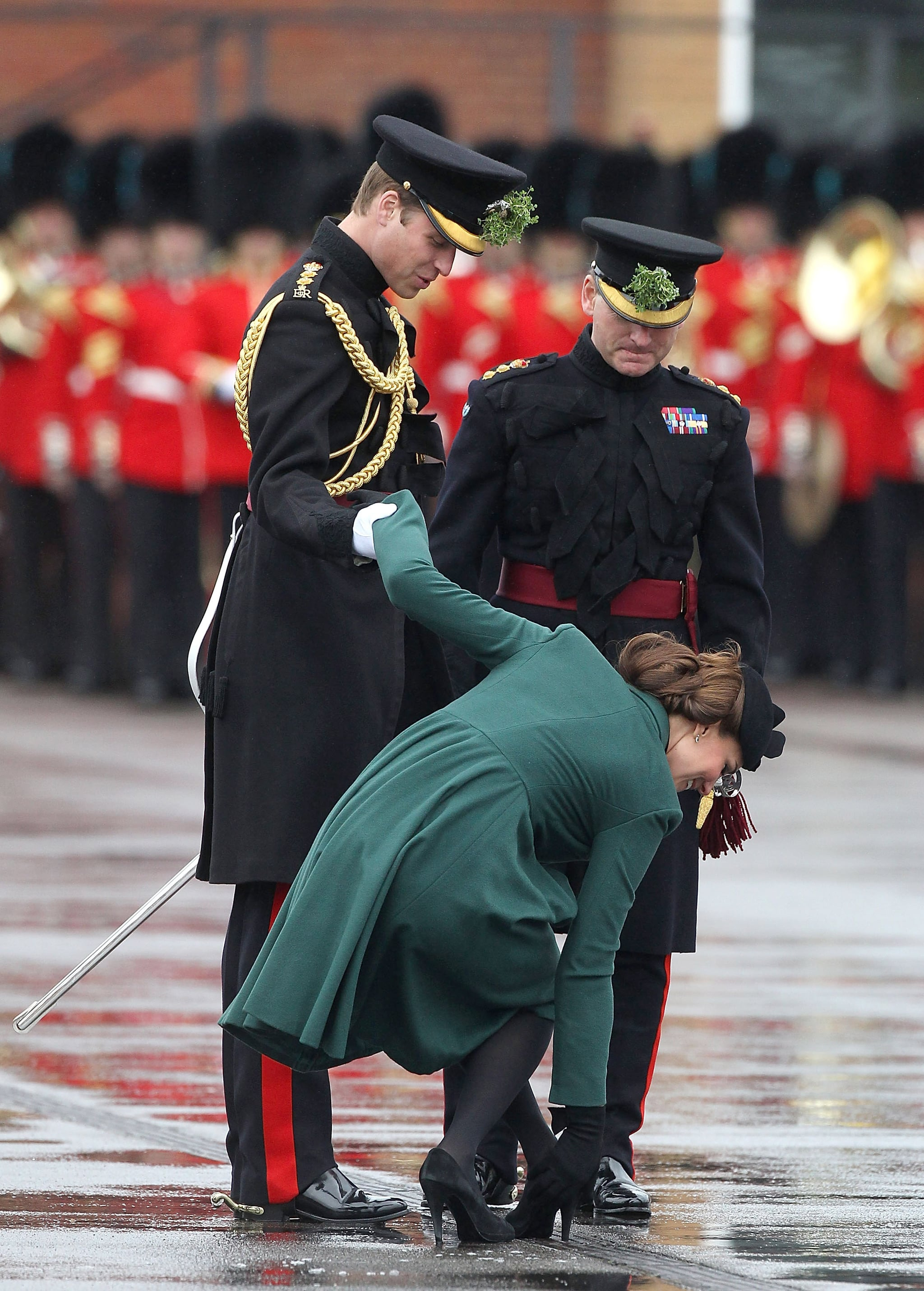 Prince William was quite the gentleman helping Kate with her shoe in March 2013 in England.
