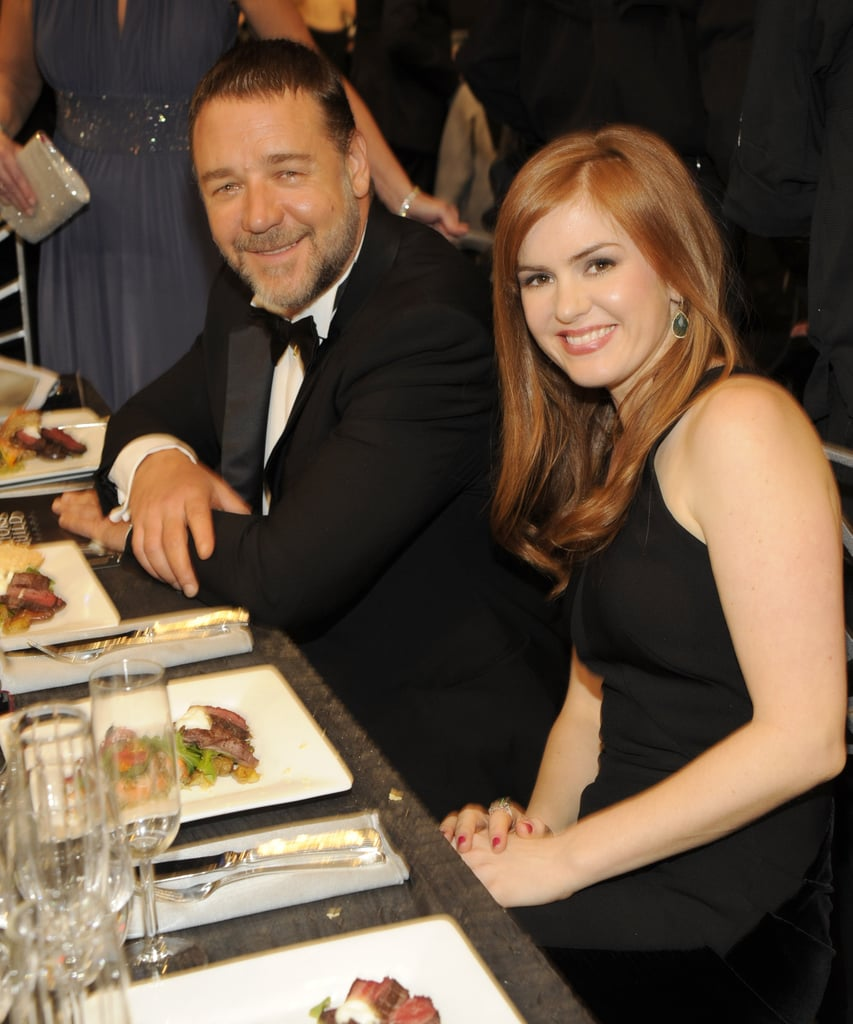 Russell Crowe sat next to Isla Fisher.