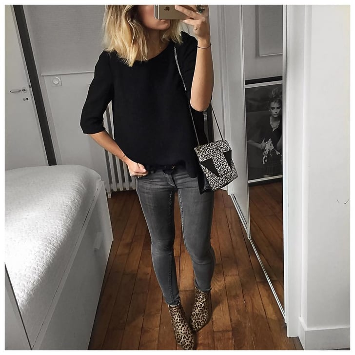 A Black Sweater Dark Wash Jeans And Leopard Booties