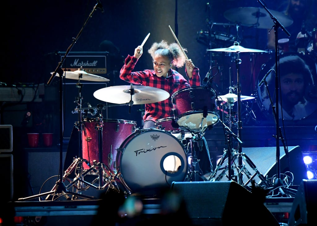"""The sweet story of an internet-famous drum prodigy has come full circle. After previously going viral for her cover of Nirvana's """"In Bloom,"""" which then sparked a virtual drum battle with Nirvana drummer and Foo Fighters frontman Dave Grohl, 11-year-old Nandi Bushell was asked to perform with the musician during an Aug. 26 concert at The Forum in Inglewood, CA. Nandi tweeted, """"It happened!!!"""" Adding, """"I had the best night ever jamming with you.""""  """"I had the best night ever jamming with you."""" Nandi joined YouTube when she was just 6 years old. Her first video shows her jamming with her dad, who's playing the guitar. As her skills rapidly grew, so did her audience, with her cover of Metallica's """"Enter Sandman"""" surpassing 600,000 views. (She was 7 years old at the time.) She's since met Lenny Kravitz, been featured in Rolling Stone, and will make an appearance in Disney's forthcoming Cinderella remake.  Preceding their recent onstage reunion, Dave praised Nandi in an interview with The New York Times last year, sharing his thoughts on her viral Nirvana cover. """"I watched it in amazement, not only because she was nailing all of the parts, but the way that she would scream when she did her drum rolls. There's something about seeing the joy and energy of a kid in love with an instrument,"""" he said. """"She just seemed like a force of nature."""" Not only is Dave a fan, but his fans admire her, as well: if you listen closely to the performance video, you'll hear the crowd chanting Nandi's name before she and Foo Fighters launch into """"Everlong."""" Watch the incredible performance ahead.      Related:                                                                                                           See Proud Mama Alicia Keys and 10-Year-Old Egypt Duet """"Sweet Dreams"""" on the Piano"""