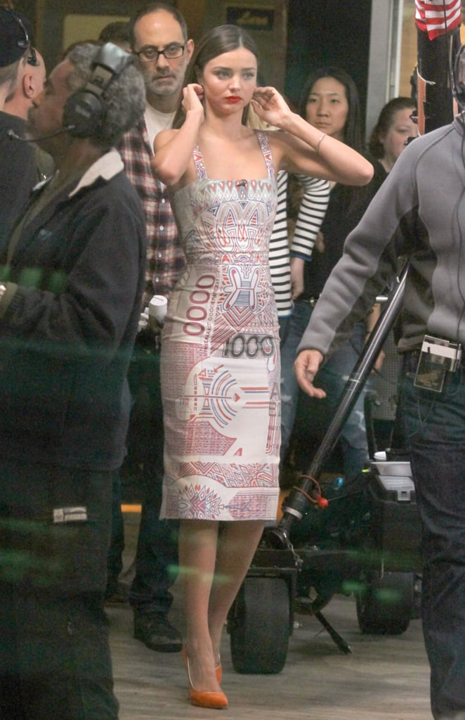 During her Good Morning America appearance in NYC, Miranda got print-happy in a printed knee-length, square-neck Mary Katrantzou dress and orange Casadei pumps.