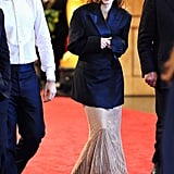 Jessica Chastain held onto her coat as she left the Oscars.