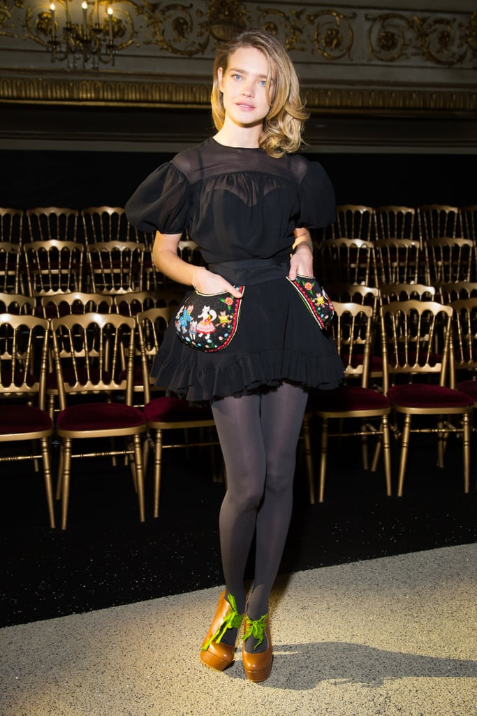 Natalia Vodianova made a voluminous LBD pop with semi-sheer grey tights and a bright pair of booties at the Ulyana Sergeenko show.