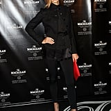 Stacy Keibler added a pop of color with a red clutch at The Macallan Masters of Photography Series Launch in NYC.
