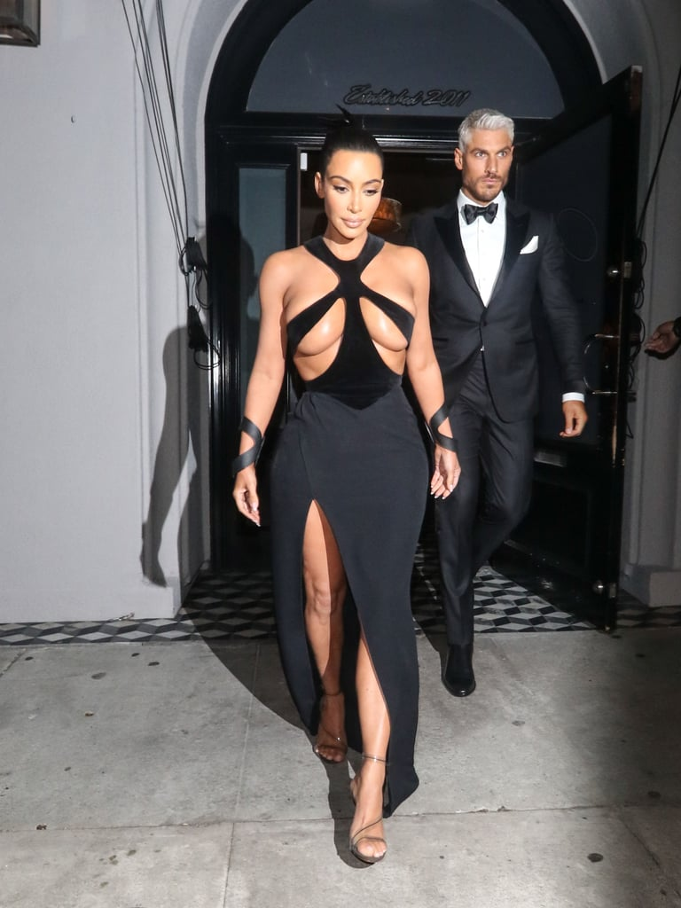 "By now, most of us have seen the photos of Kim Kardashian wearing a dress that left pretty much nothing to the imagination (which made us nervous just looking at it,) but it seems many POPSUGAR readers were more concerned who the ""hot guy"" behind her in the photos were. ""Who's the silver fox behind her?"" you asked. ""Can we talk about the gorgeous man behind her?"" you pleaded. Well, your wish is our command. The guy accompanying Kardashian is Chris Appleton, hairstylist to the stars, creator of the snatched ponytail, and owner of some incredibly handsome grey hair. No, he's not Kardashian's bodyguard, but he's equally important as the man behind some of her best hair colour transformations. Trust us, this man can deliver a mean ponytail.  Originally from the UK, Appleton worked his way up through a traditional salon setting, got his degree in hair colour, then went down an editorial hair route before making his way into the celebrity hair styling world. Now he's the go-to guy for huge celebrities, including Jennifer Lopez, Ariana Grande, and Kylie Jenner. His signature snatched pony practically gave a POPSUGAR editor superpowers. Ahead, get a closer look at the man himself, plus some of his best celebrity hair creations."