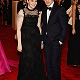 With arm tattoos on full display, Lena Dunham didn't need to worry about picking an overly punk style. Instead, she went with a frill-embellished Erdem style crafted by her dapper date, Erdem Moralioglu.