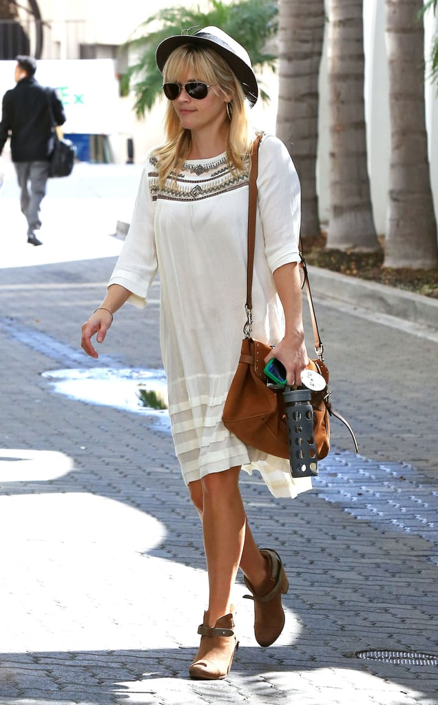 Reese Witherspoon paired her favorite Rag & Bone booties with a bohemian-style dress and hat to shop around Beverly Hills yesterday. She was solo for the outing that fell on a special day for the mother of three. Her son, Deacon Phillippe, celebrated his ninth birthday and she spent time with him ahead of his special day. Over the weekend, Reese cheered for Deacon on the sidelines of his soccer game along with husband and new dad Jim Toth. Her oldest son's big day falls close to another special occasion — it was only a month ago that Reese gave birth to her second son, Tennessee James, and first child with Jim. The star has been all about family lately. Earlier this week, Reese snuck in some girl time over lunch with Ava.