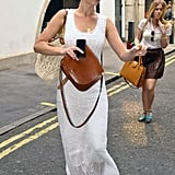 Earlier in the day, Jennifer was spotted wearing a white crochet maxi dress with Tory Burch sandals ($225), aviator sunglasses, Tory Burch's macramé Claire bag ($435), and a tan saddle bag.