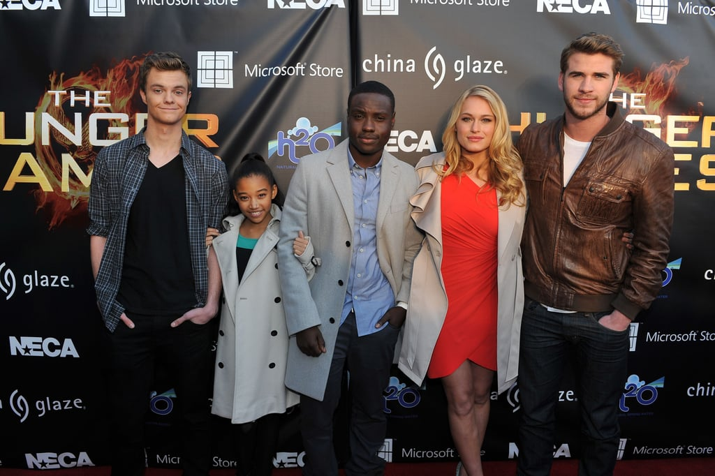 Liam Hemsworth posed with Jack Quaid, Amandla Stenberg, Dayo Okeniyi, and Levin Rambin.