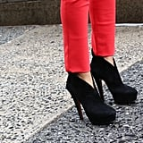 Staple black booties took a seriously glam turn with sky-high heels.