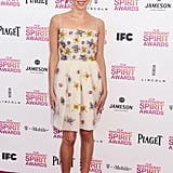Aubrey Plaza went for playful and flirty in this floral-embellished slip dress and brightly hued pointy-toe pumps.