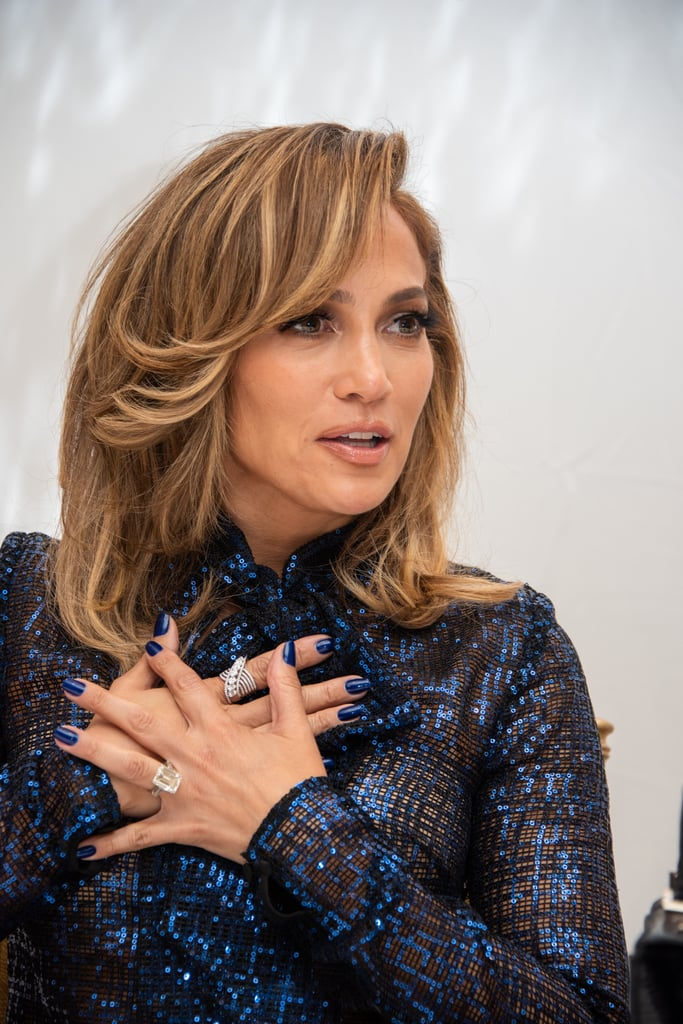 We loved the neon nail polish colors that dominated Summer, but Jennifer Lopez is showing us Fall manicures don't have to be boring. The actress and singer wore slightly metallic navy nail polish during press for her Hustlers movie, painted by celebrity manicurist Tom Bachik. While many people might be wearing neutral colors this Fall, Lopez just gave us the inspiration to mix it up with this navy color. Ahead, check out her manicure and a few navy nail polish options for Fall to try the trend yourself.