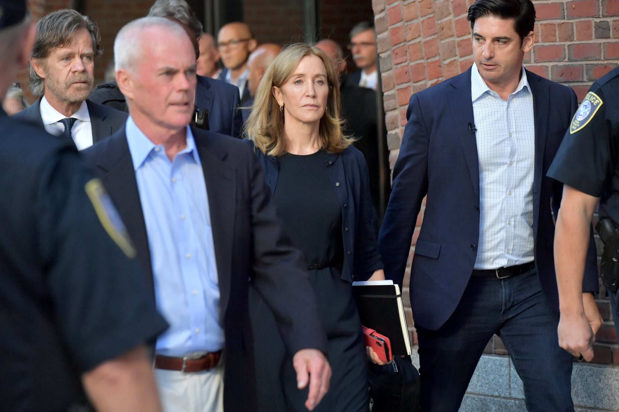 BOSTON, MA - SEPTEMBER 13:  Felicity Huffman and husband William Macy exit John Moakley U.S. Courthouse where Huffman received a 14 day sentence for her role in the college admissions scandal on September 13, 2019 in Boston, Massachusetts.  (Photo by Paul Marotta/Getty Images)