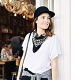 A White T-Shirt, a Black Bandana, a Black Cap, a Knotted Striped Shirt, and Black Bottoms