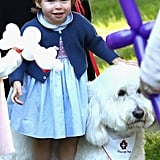 Princess Charlotte couldn't contain her excitement as she petted a fluffy dog during Kate and Will's royal tour of Canada in September 2016.