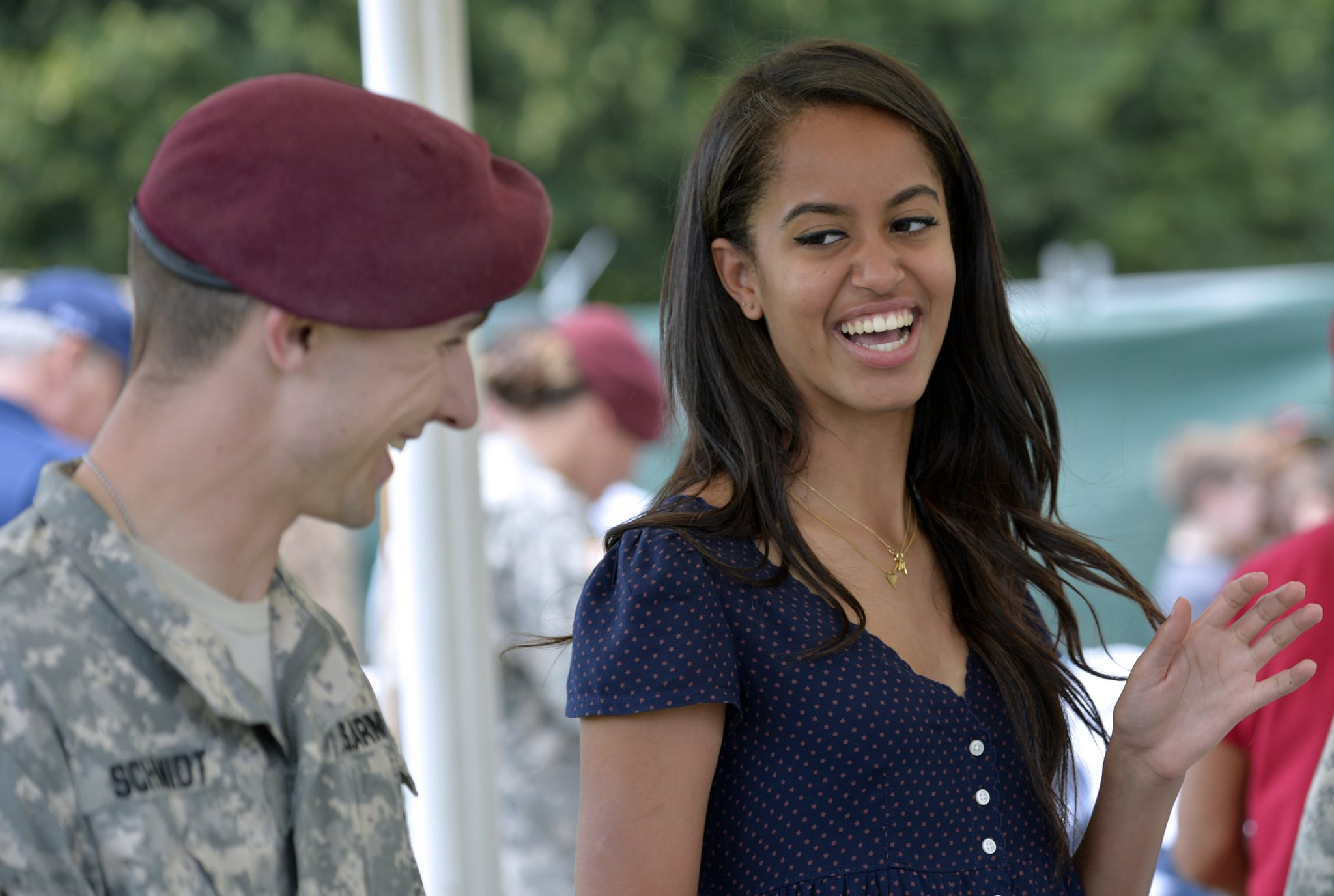 Malia Obama, daughter of US President, (R) smiles as she serves food during a lunch at the United States and Nato military base in Vicenza  on June 19, 2015 .   AFP PHOTO / ANDREAS SOLARO        (Photo credit should read ANDREAS SOLARO/AFP via Getty Images)