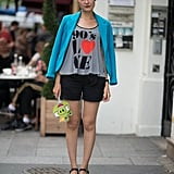 A cool way to jazz up your shorts? This style pro opted for a printed tee and a lively blazer for a seriously cool result.