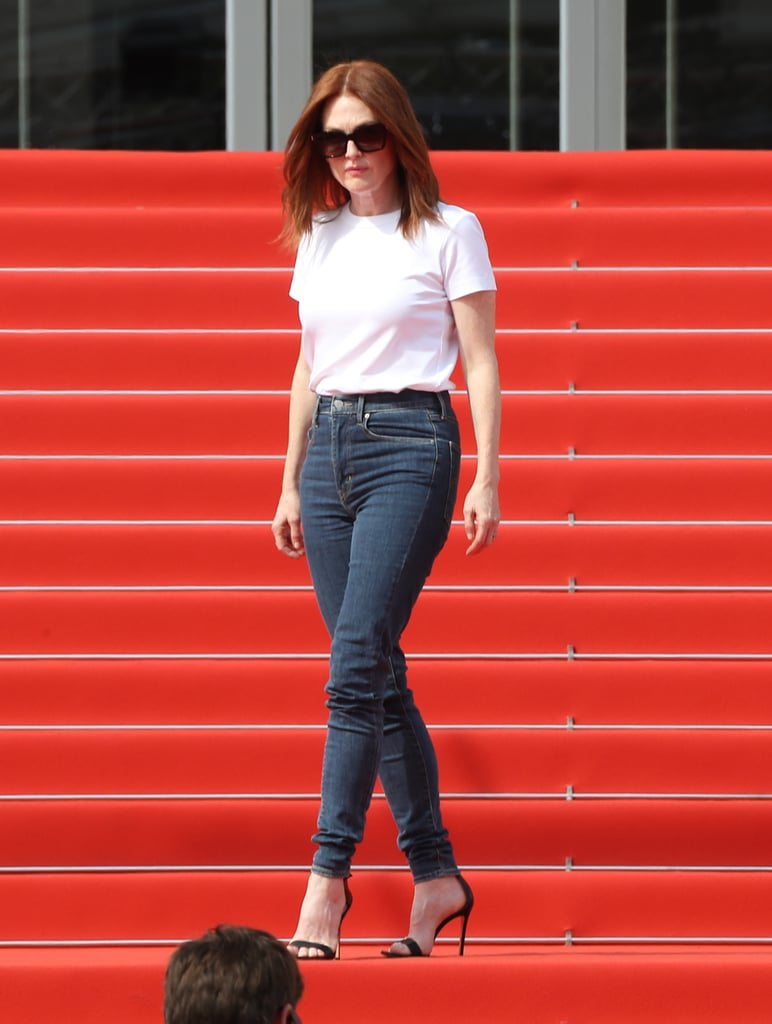 Ahead of the opening ceremony, Julianne was spotted on a shoot. For the more relaxed occasion, she wore a simple outfit composed of a white t-shirt, skinny jeans, and heeled sandals.
