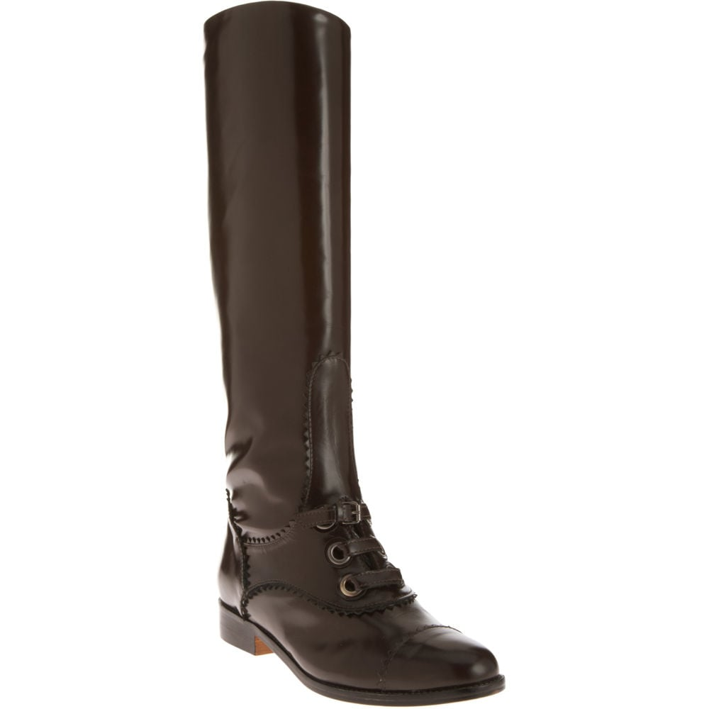 We've been pining away for these slick Carven riding boots. Carven Half Lace Knee Boot ($389, originally $985)