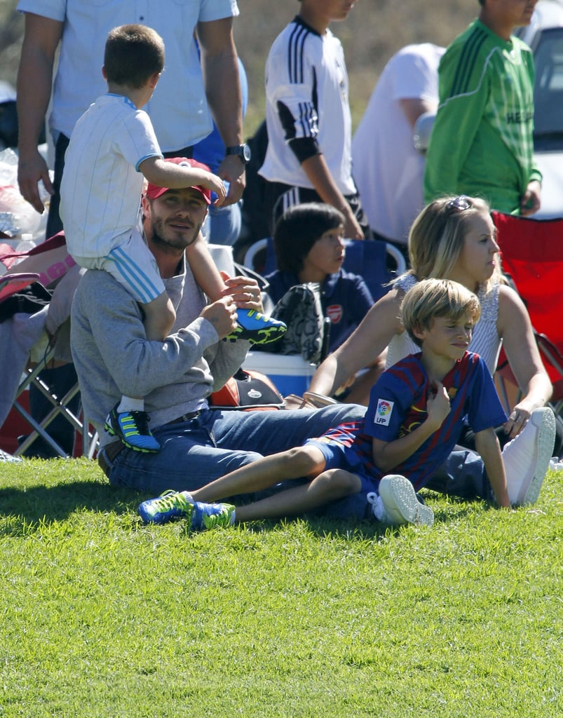 Cruz Beckham sat atop David's shoulders at a soccer game.