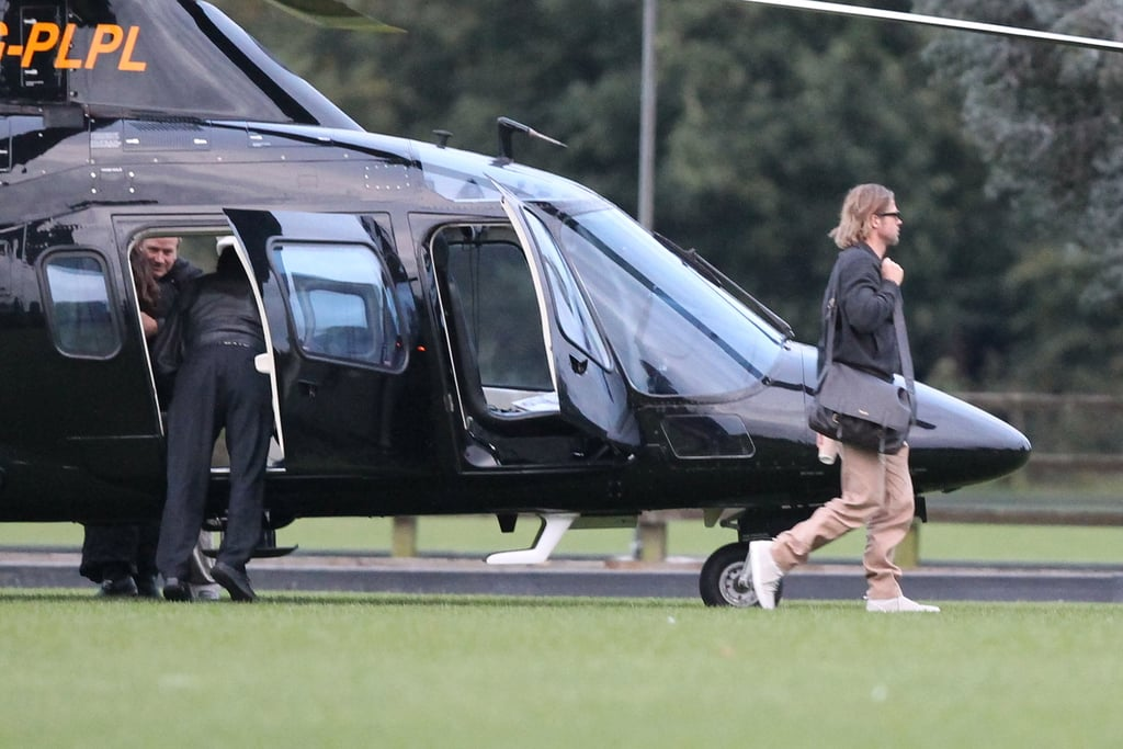 Brad Pitt arrives by helicopter.