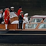 The queen's launch headed down the River Thames to begin the pageant.