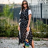 A white tee grounds a playfully printed dress and fun accessories.