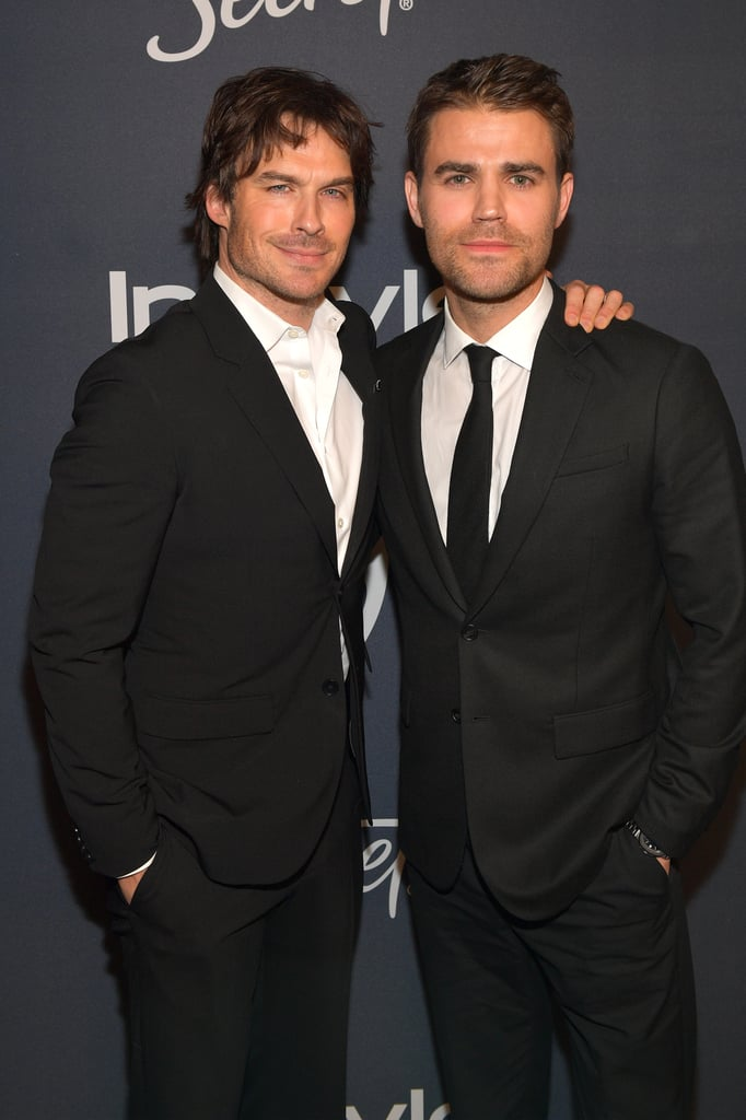 The Vampire Diaries cast recently reunited, and we're feeling pretty epic about it. Following the Golden Globes on Sunday night, the cast of the hit CW series attended the InStyle and Warner Bros. afterparty. Though exes Nina Dobrev and Ian Somerhalder, who famously played love interests Elena and Damon on the show, didn't pose for any photos together, Paul Wesley happily snapped photos with each of them. The actor, who played Stefan, posed for photos with his former onscreen brother on the red carpet, before mingling with Nina inside the event.  The cute reunion marks almost three years since the series came to a close in March 2017. Though the cast has moved on to different projects, it seems they'll always have a soft spot for their TVD roots. In fact, Ian's latest Netflix series, V Wars, is all about vampires — except this time, he's playing a human! See more of the TVD reunion ahead.