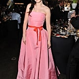 Presenter Zooey Deschanel posed in a pink strapless dress at the Governors Ball.