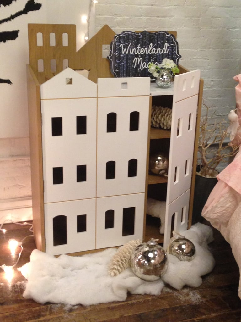 This would make the coolest combo storage unit/playhouse for a city kid — it looks like a row of brownstone houses!