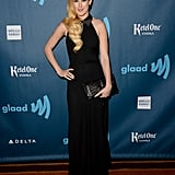 Rumer Willis chose an elegant halter-style black gown and finished the look with an oversize clutch and perfectly coiffed waves.