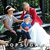 Amy Poehler Gets Close With Pal Paul and Son Archie on Set