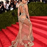 Wearing an embellished sheer Givenchy gown to the Met Gala in 2015.