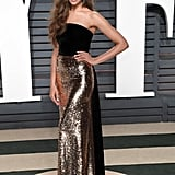 At the 2017 Vanity Fair Oscar party wearing Monique Lhuillier.