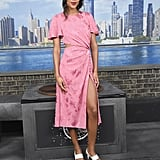 Wearing a baby pink silk Prabal Gurung dress that featured a thigh-high slit.