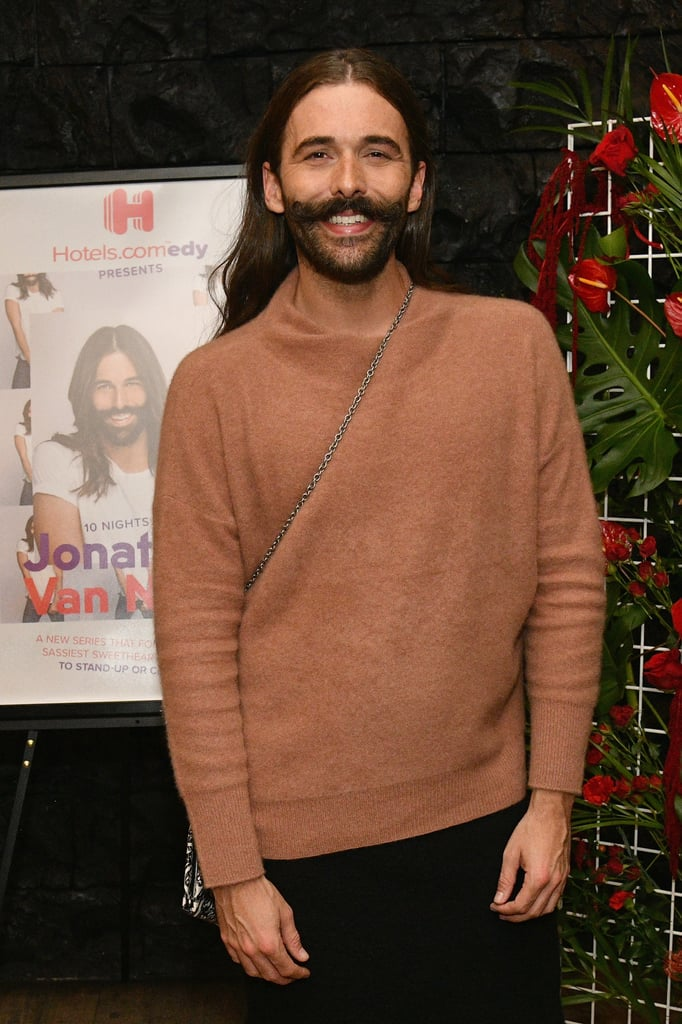 "Attention, beautiful people: the comedy scene just got way more fabulous — and funnier, too. Queer Eye's appointed groomer and hairdresser Jonathan Van Ness is breaking into the world of stand-up in partnership with Hotels.com. The booking giant chronicled Van Ness's Fall comedy tour in a new docuseries titled 10 Nights With Jonathan Van Ness. He hit up a number of cities — including Seattle, NYC, and Kansas City, MO — across the nation, bringing his humor, positivity, and bright attitude to the stage. POPSUGAR spoke to Van Ness and learned more about his love for comedy and details about the docuseries. In the 10-part series, which you can watch on YouTube, viewers will see Van Ness travel from city to city, living out his stand-up comedy dream — but they'll also see all the ups and downs that come along with starting something new. ""Definitely there [have] been times where I tried out a bit, and it didn't land the way I thought it was going to land,"" Van Ness told POPSUGAR. ""I think you see me really in the process of performing and editing the performance as I'm going. It really feels like an authentic peek into what those experiences look like."" Although he's new to the stand-up scene, the TV personality certainly isn't a stranger to comedy. Aside from giving fans a lot of good laughs on Queer Eye, Van Ness has also starred in Funny or Die's YouTube series Gay of Thrones since 2013. The show features Van Ness giving lively recaps of HBO's Game of Thrones while doing clients' hair. Through that, he met Drop Dead Diva star and comedy legend Margaret Cho and became her hairdresser.  ""During the shows, I feel just so present and so energetic and also kind of in awe. I can't tell you how many times a day I'm like, 'I can't even believe this is my life.'""  But Cho saw much more in him and continuously encouraged him to pursue a career in stand-up, even though Van Ness initially pushed back on the idea. ""I had impostor syndrome already because I look up to her so much,"" Van Ness said. ""People spend their whole professional lives trying to burst onto this scene, and I didn't see that I was good enough."" He finally gathered the courage to set his fears aside after filming Queer Eye in 2017 and accompanied a few friends to stand-up shows in LA, where he performed for the first time in a major way. That's when things started to click. ""I was like, oh, my God. I love this so much. It's so fun. It's like a whole new medium of communication for me,"" he said. That's also when Hotels.com reached out to propose the idea of the docuseries.  A lot of Van Ness's comedic material comes from things he's passionate about — the Olympics, film, TV shows. He has also started keeping tabs on everyday inspirations that hit him. ""I have my phone with me all the time, and I'll just write things down; like situations or jokes or bits that I think are funny,"" he said. And if he needs any more inspiration, he just channels ""some good old fashioned gay rage.""  While Van Ness admits that he usually has butterflies in his stomach right before a show, you can hardly tell; he totally captivates audience members with his confidence and inviting smile. ""During the shows, I feel just so present and so energetic and also kind of in awe. I can't tell you how many times a day I'm like, 'I can't even believe this is my life,'"" he said. The overarching theme of the docuseries is to simply do what you want to do, go after what you want, and don't be afraid to fail. ""There [are] just so many ways to get to your goal,"" Van Ness emphasized. ""Just because I wasn't at open mic nights at midnight five nights a week doesn't make my path any less OK. Everyone has their own path and their own way."" And that sense of self-assurance and willingness to live and learn are precisely why he's determined to ""stand-up or cry trying."" Watch Van Ness on his journey to developing his stand-up career in the episodes of 10 Nights With Jonathan Van Ness ahead. Hotels.com will release an episode every other day on YouTube, so be on the lookout for the next clip! Then, see photos of him at the docuseries's premiere party in New York."