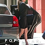 Angelina Jolie showed off her legs in a black skirt.