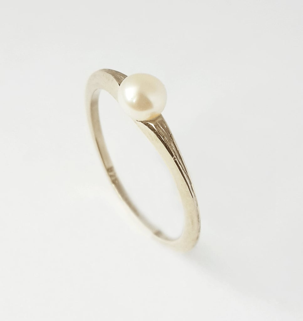 We love the clean and smooth finish on the band of this engagement ring ($110).