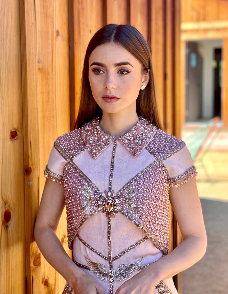 "Lily Collins looked ready for battle — or, you know, to present — at the 2021 SAG Awards on Sunday. The Emily in Paris actress wore a pink, heavily embellished Georges Hobeika dress that almost resembled armor. The detailed minidress featured a collar neckline and a pair of wings beaded on the waistline. Styled by Rob Zangardi and Mariel Haenn, the look was completed with Casadei heels in a similar pink shade and diamonds by Cartier. ""Might be a little dressed up for the location,"" wrote Lily, who appeared from home like her fellow attendees. Regardless, she was certainly ""puttin' on the glitz,"" as her caption noted. See photos ahead.      Related:                                                                                                           Dan Levy Was a Breath of Fresh Spring Air in This Bespoke Suit at the 2021 SAG Awards"